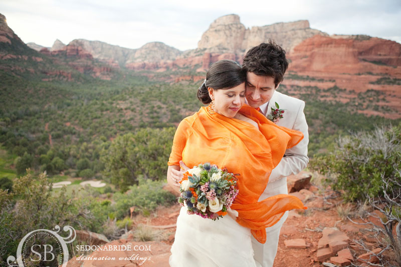 A bride and groom on Rachel's Knoll at Seven Canyons Resort