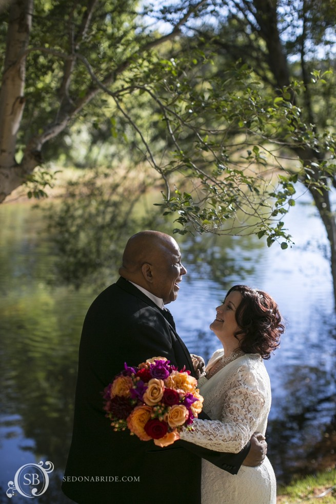 couple enjoy private moment by Oak Creek at Sedona wedding