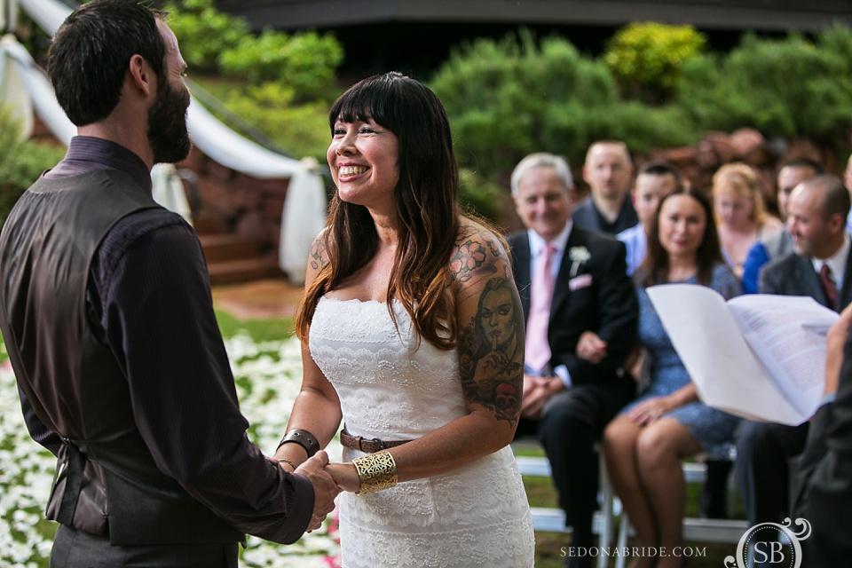 Happy wedding bride looks into the eyes of her groom.