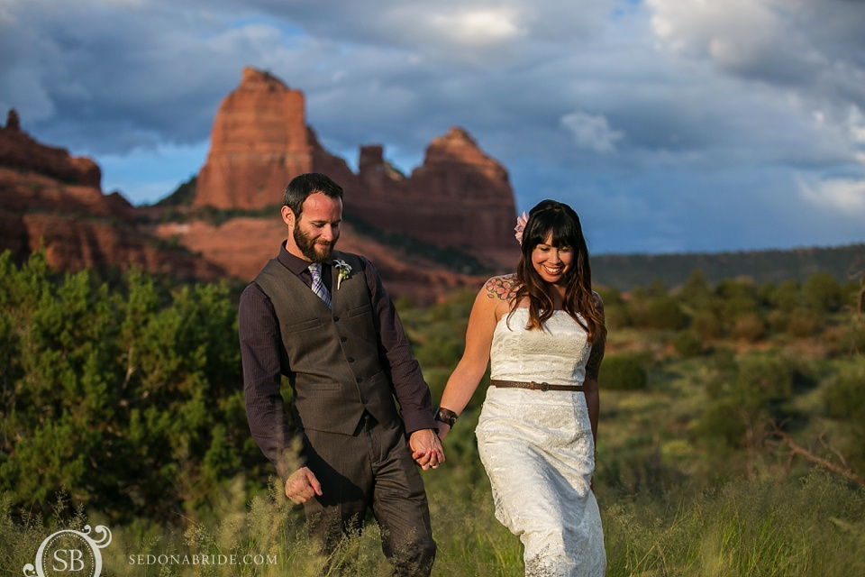 This Sedona bride and groom go offsite to have some pictures taken on Schnebly Hill Road among the red rocks