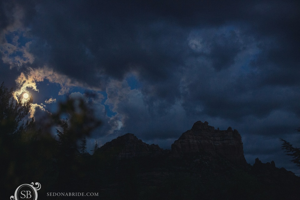The Sedona full blood moon hides behind the clouds after a beautiful wedding ceremony and day in the northern Arizona